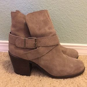 These are BCBGeneration booties in a taupe color.